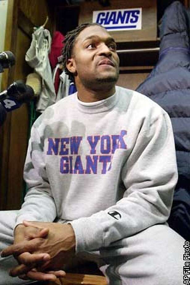 ADVANCE FOR WEEKEND EDITIONS, DEC. 30-31 -- New York Giants wide receiver Amani Toomer smiles as he listens to a reporter's question in the Giants locker room, Wednesday, Dec.27, 2000, at Giants Stadium in East Rutherford, N.J., following a practice for the NFL playoffs. Toomer became the first Giant in nearly 40 years with two straight season of more than 1,000 yards receiving. (AP Photo/Kathy Willens) Photo: KATHY WILLENS