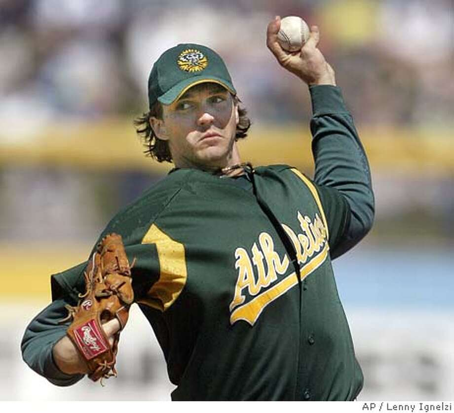 ** ADVANCE FOR WEEKEND EDITIONS, APRIL 2-3 ** FILE **Oakland Athletics' Barry Zito pitches in the first inning against the Seattle Mariners in Peoria, Ariz., March 15, 2005. Zito and Eric Chavez are the only remaining members of the Oakland Athletics to play for every playoff team since 2000. (AP Photo/Lenny Ignelzi, File) ADVANCE FOR WEEKEND EDITIONS, APRIL 2-3; A MARCH 15, 2005, FILE PHOTO Photo: LENNY IGNELZI