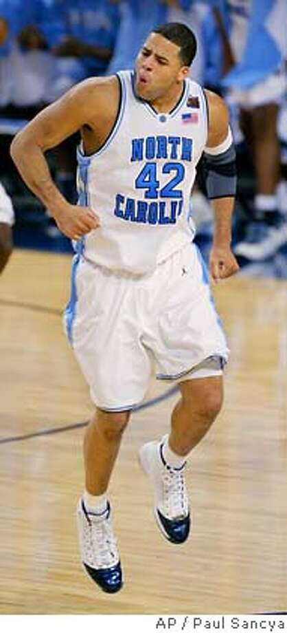 North Carolina's Sean May celebrates after the Tar Heels beat Michigan State 87-71 in a semifinal game at the Final Four on Saturday, April 2, 2005, at the Edward Jones Dome in St. Louis. (AP Photo/Paul Sancya) Photo: PAUL SANCYA