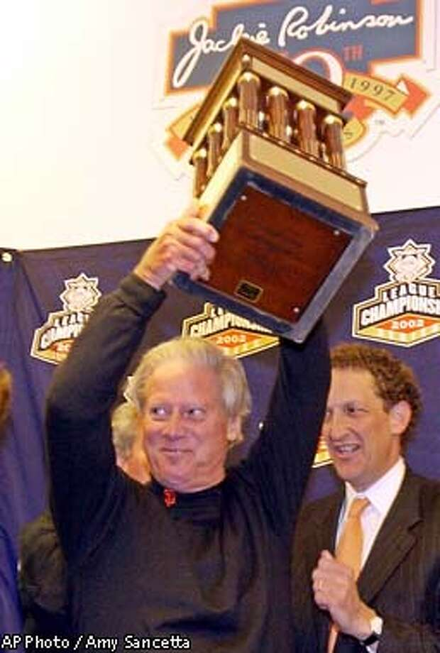 San Francisco Giants Peter Magowan, managing general partner, left, and Larry Baer, executive vice-president and COO of the Giants, hoist the championship trophy after the Giants beat the St. Louis Cardinals 2-1, during game five of the NLCS in San Francisco, Monday, Oct. 14, 2002. (AP Photo/Amy Sancetta) Photo: AMY SANCETTA