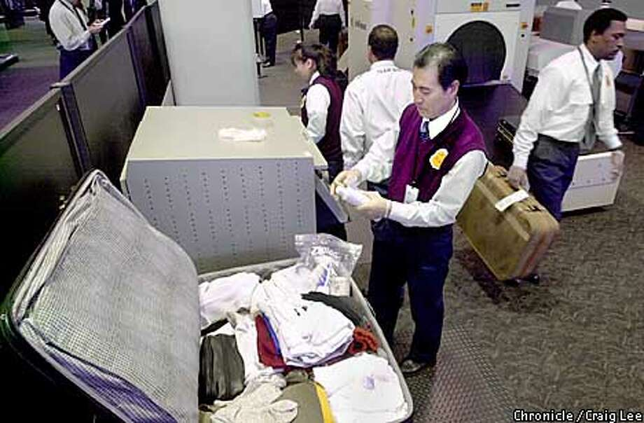 Security screening all checked bags at San Francisco International Airport. This is now the how all security is being done as of midnight tonight at all airports. Photo of TSA worker, Sung Han, testing some luggage contents for explosives.  Photo by Craig Lee/San Francisco Chronicle Photo: CRAIG LEE