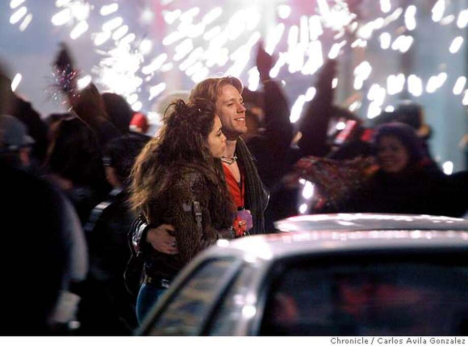 """Rosario Dawson as Mimi Marquez, and Adam Pascal as Roger Davis during the filming of Rent on 6th Street in San Francisco, Ca. A major movie, """"Rent,"""" is being (partly) filmed on Thursday, March 31, 2005, in The Chronicle's backyard, namely Sixth Street and Jessie. The film stars Rosario Dawson and Taye Diggs, directed by Chris Columbus. Photo by Carlos Avila Gonzalez / The San Francisco Chronicle  Photo taken on 4/1/05 in San Francisco, CA. MANDATORY CREDIT FOR PHOTOG AND SAN FRANCISCO CHRONICLE/ -MAGS OUT Photo: Carlos Avila Gonzalez"""