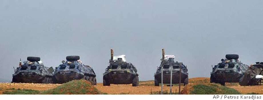 ** RECROPPED VERSION ** An array of Syrian armoured vehicles are seen at an army camp in Bekaa Valley east of Beirut, Lebanon, Sunday April 3, 2005. The Syrian government has promised to remove all its troops and intelligence agents from Lebanon by April 30, the U.N. envoy said Sunday after meeting with Syria's president and foreign minister. (AP Photo/Petros Karadjias) ALTERNATIVE CROP Photo: PETROS KARADJIAS
