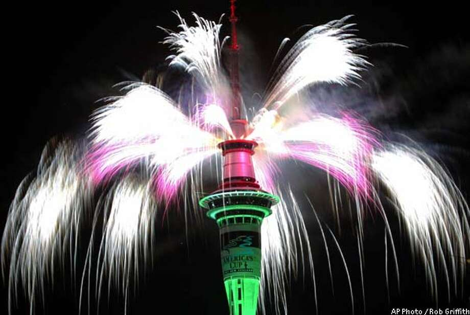 The Sky Tower in Auckland, New Zealand, explodes in a flurry of fireworks at the stroke of midnight Wednesday, Jan. 1, 2003. (AP Photo/Rob Griffith) Photo: ROB GRIFFITH