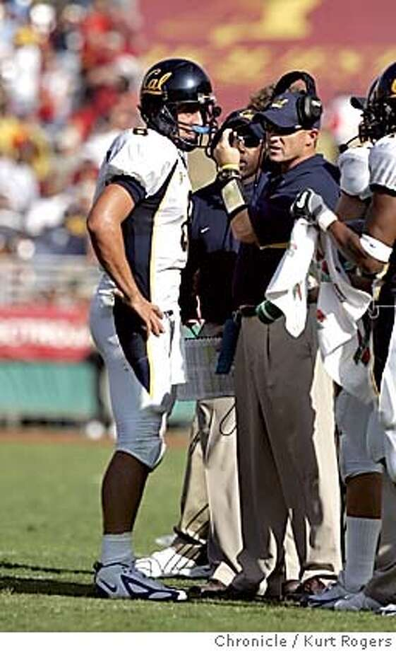 With 1:21 left in the game Cal called a time out and Aaron Rodgers talks it over with coachPete Carroll .  The University of California Berkeley Golden Bears vs the University of Southern California Trojans at the Los Angeles Memorial Coliseum.  CAL_641_kr.JPG 10/9/04 in Los Angeles,CA.  KURT ROGERS/THE CHRONICLE MANDATORY CREDIT FOR PHOTOG AND SF CHRONICLE/ -MAGS OUT Sports#Sports#Chronicle#10/11/2004#ALL#5star##0422404167 Photo: KURT ROGERS