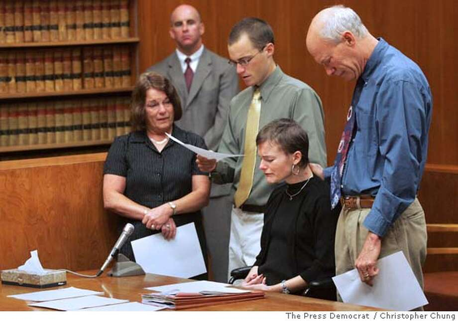 Photo by Christopher Chung/ The Press Democrat Daniel Mason, center, reads a statement requesting that Harvey Hereford be given the maximum sentence, alongside his mother, Joanne Mason, left, sister, Jill Mason, and father, Larry Mason, as deputy district attorney William Brockley, listens in the background. Harvey Hereford was sentenced to eight years and eight months for the drunk driving incident that killed Alan Liu and injured Jill Mason last April. Photo: Christopher Chung