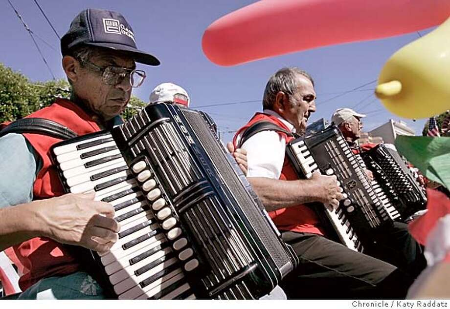 ITALIAN128_rad.jpg SHOWN: Hard-playing members of the San Francisco Accordion Club belt out favorites as they move down Columbus Avenue. Italian Heritage parade through the streets of North Beach. Katy Raddatz / The Chronicle MANDATORY CREDIT FOR PHOTOG AND SF CHRONICLE/ -MAGS OUT Metro#Metro#Chronicle#10/11/2004#ALL#5star##0422406377 Photo: Katy Raddatz