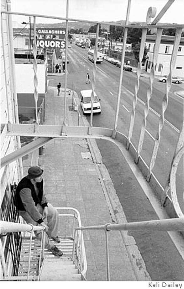 """""""MLK everywhere seems filled with hardships and hope,"""" says Dan Paul. Overlooking Martin Luther King, formerly known as Grove Street, on the fire escape of his apartment. 2005 Photo: Keli Dailey"""