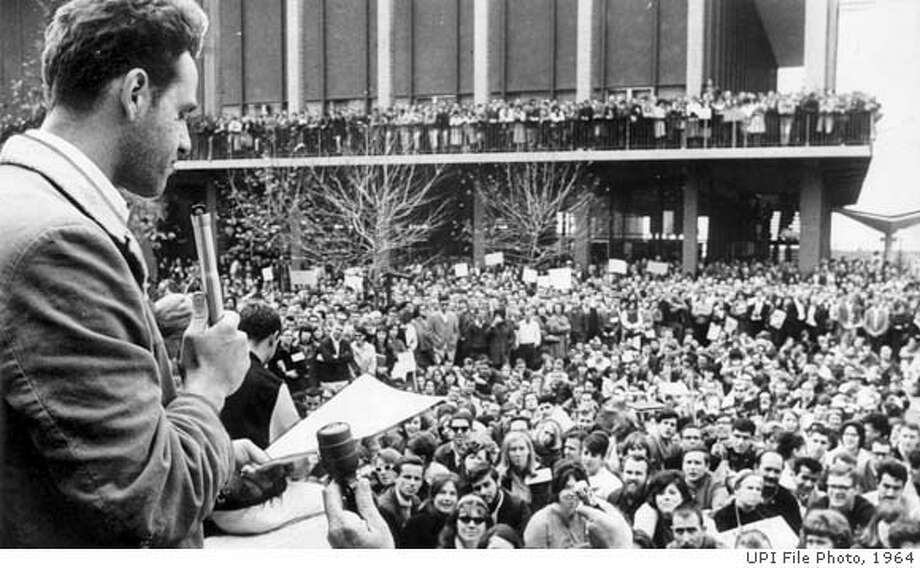 SAVIO 2/B/12MAY64/MN/UPI - Mario Savio (l) one of the leaders of the FSX movement at the University of California, tells 5,000 people at rally in Berkeley 12/4/64, that his group would continue efforts to expand political freedom on the campus. The Free Speech Movement called a general strike 12/4/64 wyhich has disrupted this campus for the second considective day. Photo by UPI ALSO RAN: 12/4/97 - 3 CAT Photo: UPI