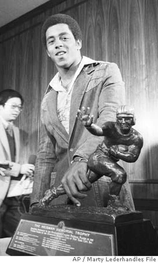 Tony Dorsett, University of Pittsburgh running back gets a good grasp on the 1976 Heisman trophy which was awarded to him in New York Nov. 30, 1976. (AP Photo/Marty Lederhandler) Photo: MARTY LEDERHANDLER