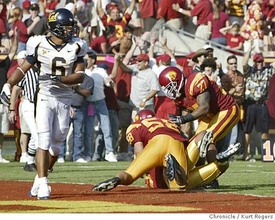 At the end cal's Geoff Mcarthur walks off the field with USC celebrating in the endzone.  The University of California Berkeley Golden Bears vs the University of Southern California Trojans at the Los Angeles Memorial Coliseum. 10/9/04 in Los Angeles,CA.  KURT ROGERS/THE CHRONICLE Photo: KURT ROGERS