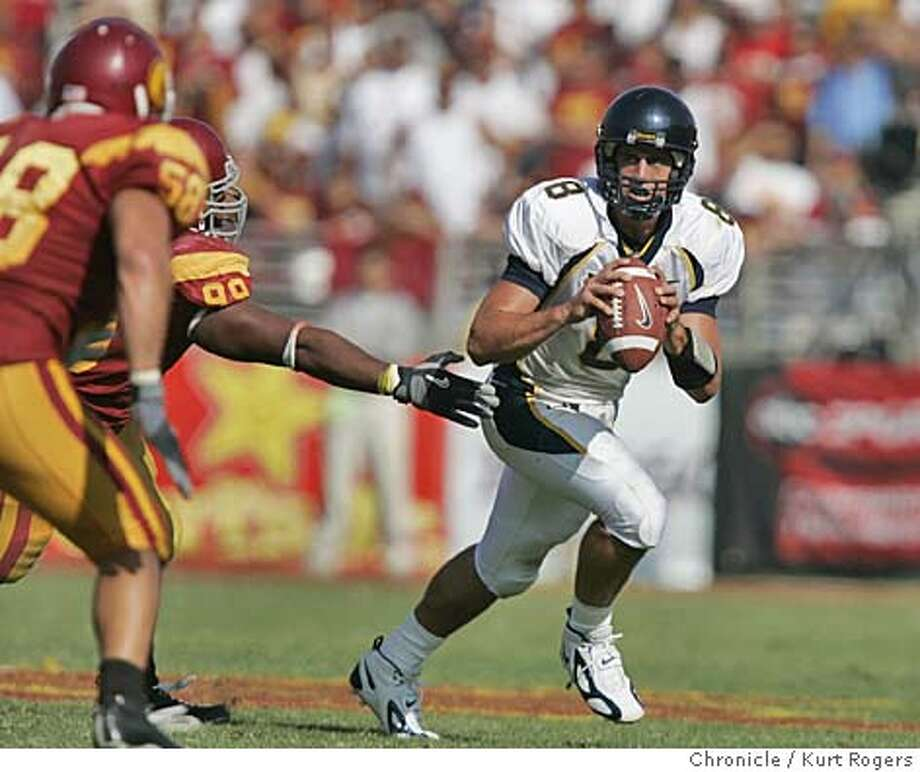 Aaron Rodgers looks down field in the 4th The University of California Berkeley Golden Bears vs the University of Southern California Trojans at the Los Angeles Memorial Coliseum.  CAL_530_kr.JPG 10/9/04 in Los Angeles,CA.  KURT ROGERS/THE CHRONICLE MANDATORY CREDIT FOR PHOTOG AND SF CHRONICLE/ -MAGS OUT Sports#Sports#Chronicle#10/10/2004#ALL#5star##0422404254 Photo: KURT ROGERS