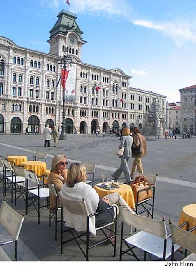 TRAVEL TRIESTE -- Caffe degli Specchi, in Trieste's Piazza dell'Unita d'Italia, has been the city's prime people-watching spot since it opened in 1839. Credit: John Flinn Ran on: 10-10-2004  Caff� degli Specchi in Trieste's Piazza dell'Unit� d'Italia, the main square, has been the Italian city's prime people-watching spot since it opened in 1839. Photo: John Flinn