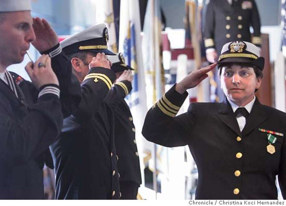 Sister Moses's final salute, as she leaves her ceremony.This weekend, five years after she entered the convent, Sister Donna Moses will retire from her service to the Navy and change from a sailor's uniform to a nun's habit for the last time. Alameda, CA .CHRISTINA KOCI HERNANDEZ/CHRONICLE Photo: CHRISTINA KOCI HERNANDEZ