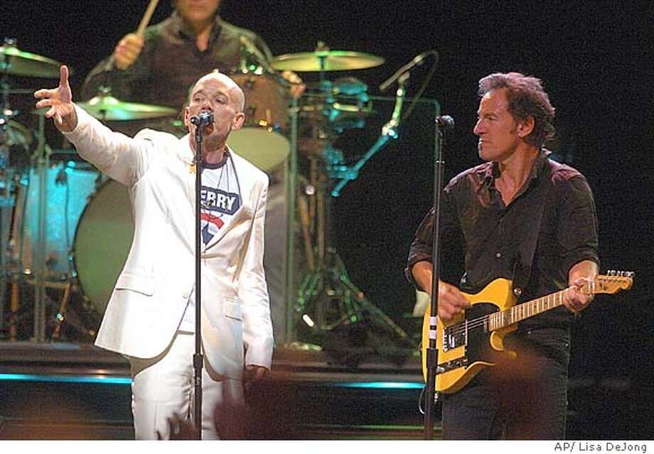 "Michael Stipe from the band REM, left, sings ""Because The Night"" written by Bruce Springsteen, right, during the 'Vote For Change"" concert at Cobo Arena in Detroit, Sunday, Oct. 3, 2004. (AP Photo/  The Flint Journal, Lisa DeJong) Insight#Insight#Chronicle#10/10/2004##Advance##0422393434 Photo: LISA DEJONG"