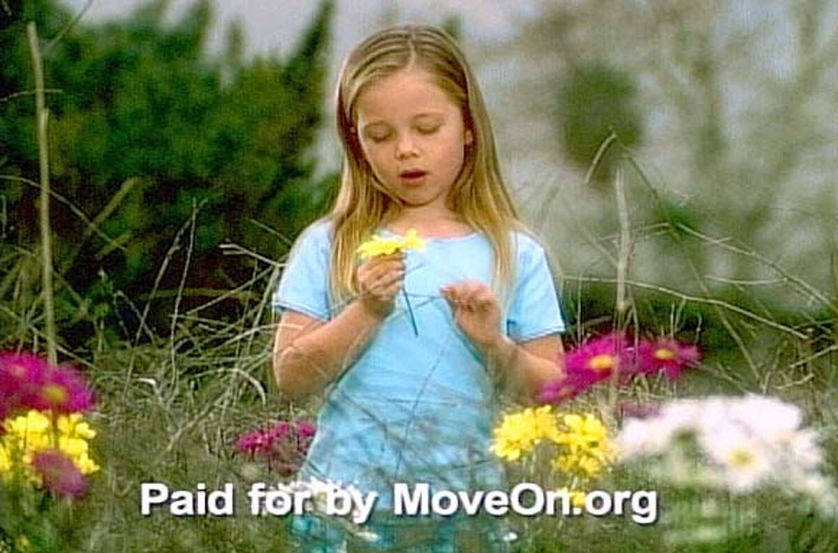 Revisiting a jarring television commercial from the Cold War era, anti-war group MoveOn.org has remade the 1964 'Daisy' ad, warning that a war against Iraq could spark a nuclear Armageddon. As in the original, when the little girl finishing plucking petals from the flower, the image changes into the mushroom cloud of a nuclear explosion. The ad will air in 12 cities around the United States on January 16, 2003. REUTERS/HO/MoveOn.org ALSO RAN 02/09/03 CAT 0 Insight#Insight#Chronicle#10/10/2004##Advance##421183538