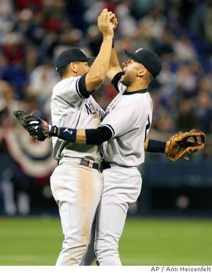 New York Yankees' Derek Jeter, right, and Alex Rodriguez, left, celebrate after getting the final out against the Minnesota Twins in Game 4 of division series playoffs in Minneapolis, Saturday, Oct. 9, 2004. The Yankees beat the Twins 6-5 in 11 innings to win the series. (AP Photo/Ann Heisenfelt) Sports#Sports#Chronicle#10/10/2004#ALL#5star##0422404205 Photo: ANN HEISENFELT