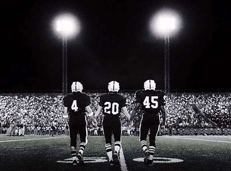 (L to r) Permian Panthers Brian Chavez (JAY HERNANDEZ, #4), Mike Winchell (LUCAS BLACK, #20) and Boobie Miles (DEREK LUKE, #45) take to the field for the pre-game coin toss in Imagine Entertainment?s adaptation of H.G. Bissinger?s prize-winning book, Friday Night Lights. Datebook#Datebook#SundayDateBook#10-10-2004#ALL#Advance##0422387904 Photo: Credit: Universal Pictures