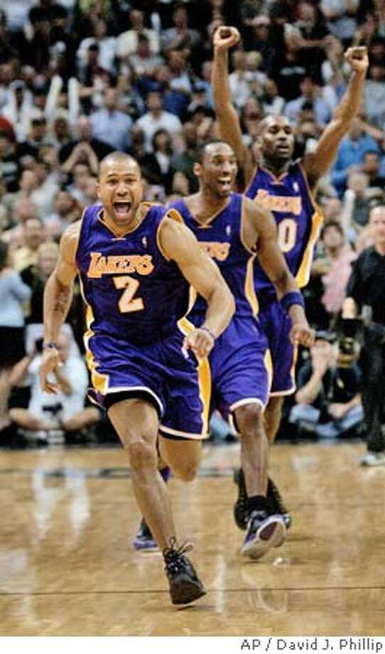 Los Angeles Lakers' Derek Fisher (2) celebrates with teammate Kobe Bryant (8) and Gary Payton (20) after beating the San Antonio Spurs in Game 5 of the Western Conference semifinals Thursday May 13, 2004 in San Antonio. Fisher hit a basket at the buzzer to lift the Lakers to a 74-73 win over the Spurs. The Lakers lead the best-of-seven series 3-2. (AP Photo/David J. Phillip) Derek Fisher is exuberant, as are Kobe Bryant and Gary Payton, after stealing a victory in Game 5 at San Antonio. Derek Fisher is exuberant, as are Kobe Bryant and Gary Payton, after stealing a victory in Game 5 at San Antonio. Derek Fisher is exuberant, as are Kobe Bryant and Gary Payton, after stealing a victory in Game 5 at San Antonio. Ran on: 07-16-2004  Derek Fisher is close to signing a six-year deal with the Warriors for a reported $37 million. Ran on: 07-16-2004  Derek Fisher is close to signing a six-year deal with the Warriors for a reported $37 million. Ran on: 07-16-2004  Derek Fisher is close to signing a six-year deal with the Warriors for a reported $37 million. Ran on: 07-25-2004  ProductNameChronicle Sports#Sports#Chronicle#10/10/2004#ALL#2star##0421764757 Photo: DAVID J. PHILLIP