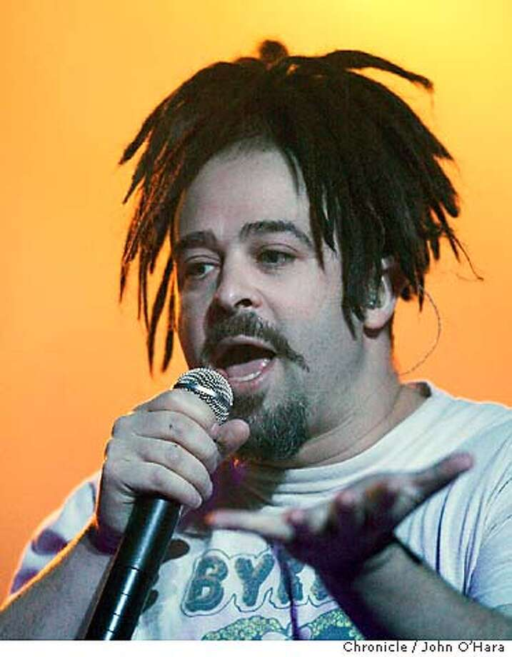 """CROWS10_029_OHARA.TIF  Warfield Theater, San Francisco,CA  """"Counting Crows"""" performs at the Warfield.  photo/John O'hara Counting Crows singer Adam Duritz seems to be wearing an octopus on his head at the Warfield. Photo caption CROWS10_PH.jpg1070841600ChronicleCROWS10_029_OHARA.TIF  Warfield Theater, San Francisco,CA  """"Counting Crows"""" performs at the Warfield.  photo-John O'hara Datebook#Datebook#Chronicle#12-10-03#ALL#3star#D1#0421521479 Datebook#Datebook#Chronicle#12/10/03#ALL#3star#D1#0421521479 Datebook#Datebook#SundayDateBook#10-10-2004#ALL#Advance##0421521479 Photo: JOHN O'HARA"""