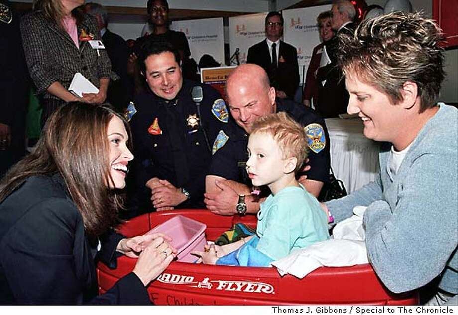 (L-R) Kimberly Guilfoyle Newsom, Deputy Chief/Administration Antonio Parra, Deputy Chief/Field Operations Greg Suhr and and Melissa Parker visit her son, Caelan Parker (7)who has received 2 liver transplants at UCSF Children's Hospital a patient at UCSF Children's Hospital.  Photo by Thomas J. Gibbons / Special to The Chronicle Living#Living#Chronicle#10/10/2004#ALL#Advance#F1#0422397372 Photo: Thomas J. Gibbons