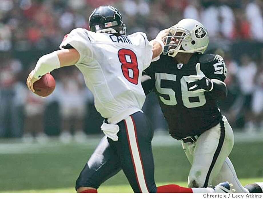 Houston Texans David Carr pushes off Raiders Travian Smith for a couple of more yards before going out of bounds on the 44 , 4th fown with 1 yard to go for a first down. OAKLAND RAIDERS vs HOUSTON TEXANS AT THE RELIANT STADIUM, IN HOUSTON TEXAS, OCT. 3, 2004. LACY ATKINS/ The Chronicle MANDATORY CREDIT FOR PHOTOG AND SF CHRONICLE/ -MAGS OUT Sports#Sports#Chronicle#10/10/2004#ALL#2star##0422392513 Photo: LACY ATKINS
