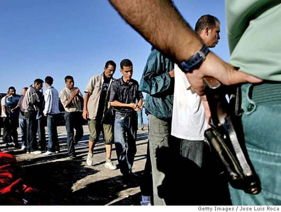 Several sub-Saharan inmigrants wait to be transferred to the southern Spanish port of Tarifa 18 August 2004 after crossing the Strait of Gibraltar in a small boat Almost 44 immigrants were detained. AFP PHOTO/ JOSE LUIS ROCA (Photo credit should read JOSE LUIS ROCA/AFP/Getty Images) Photo: JOSE LUIS ROCA
