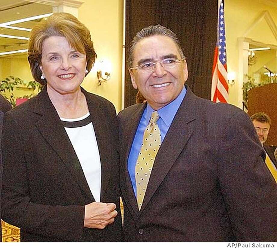 U.S. Sen. Dianne Feinstein, D-Calif., left, smiles with San Jose Mayor Ron Gonzales, right, during a meeting with Silicon Valley business leaders in San Jose, Calif., Wednesday, April 14, 2004 to discuss the flagging local economy, offshore outsourcing of jobs, tax issues and Internet access programs affecting the technology industry. Feinstein also talked about the latest developments in Iraq, the Sept. 11 Commission hearings and the growing federal deficit. (AP Photo/Paul Sakuma) San Jose Mayor Ron Gonzales is urging Washington to keep the BART project on track. ALSO RAN: 07/07/2004 Nation#MainNews#Chronicle#6/8/2004#ALL#5star##0421718306 Insight#Insight#Chronicle#10/10/2004#ALL#Advance##0421718306 Photo: PAUL SAKUMA