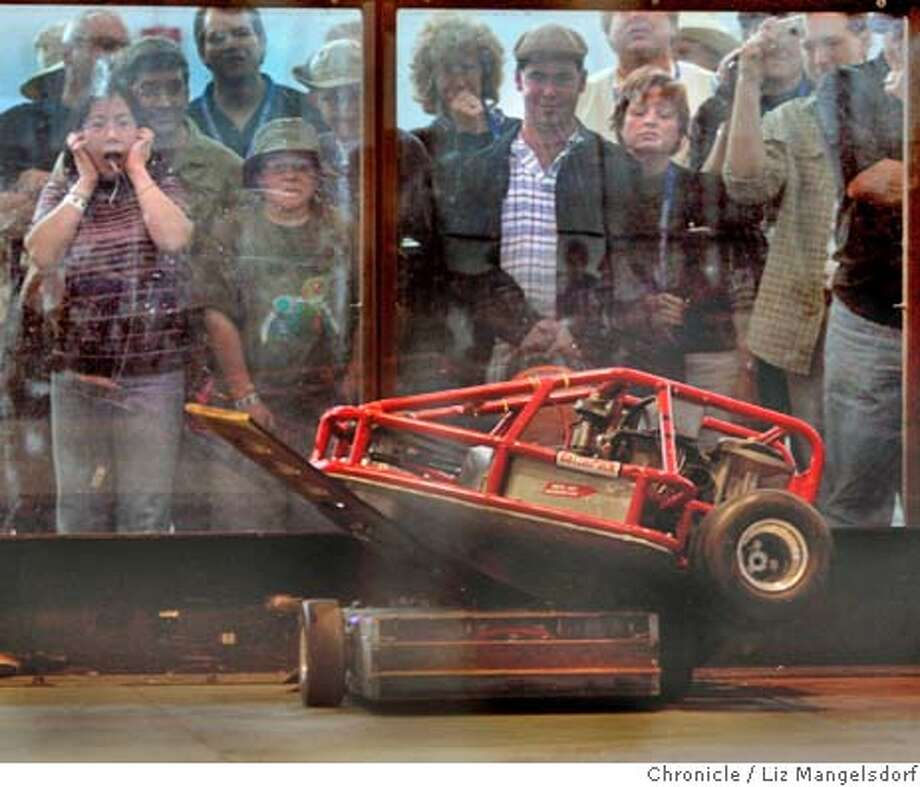 Event on 10/9/04 in San Francisco.  Spectators watch and react to the action of a fighting robot battle between the robot Final Verdict, from the team Basher of Bots, on top and Stormovik, from the team Tank Buster on bottom. Fighting robots at the Robot Fighting Leaugue's national championship at Ft. Mason in SF. The even is going on today, Saturday, and tomorrow.  Liz Mangelsdorf / The Chronicle Photo: Liz Mangelsdorf