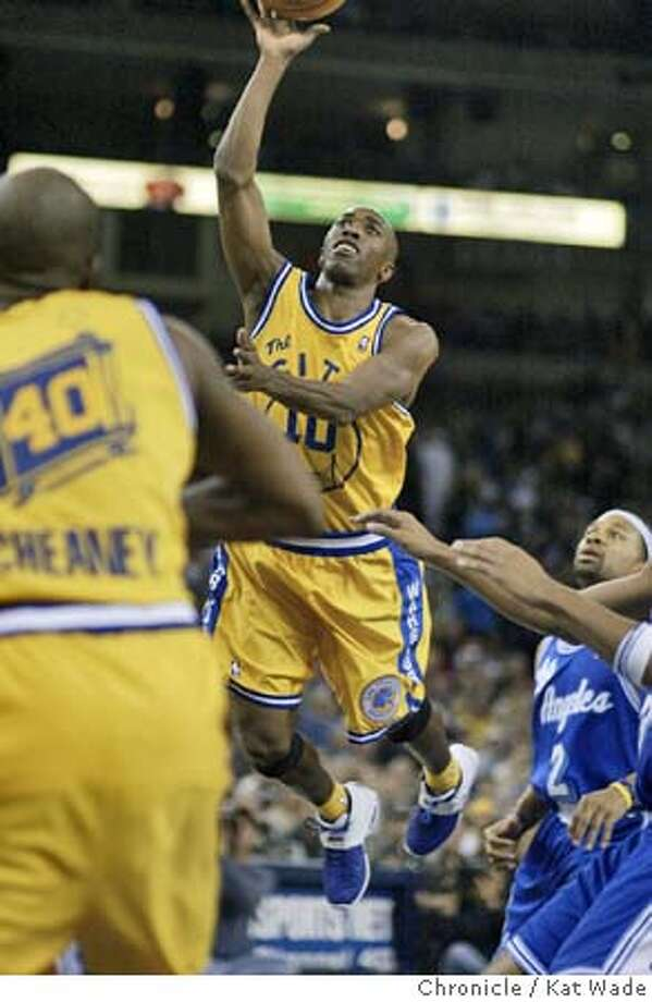 WARRIORS_0338_KW.jpg  The Golden State Warrior's Speedy Claxton leaps between two Lakers defender to core in the fourth quarterof the Warriors victory against the L.A. Lakers at the Oakland Arena on 12/23/03 in Oakland. with a final score 107 to 98.  Kat Wade / The Chronicle MANDATORY CREDIT FOR PHOTOG AND SF CHRONICLE/ -MAGS OUT Sports#Sports#Chronicle#10/9/2004#ALL#5star##0421546107 Photo: Kat Wade