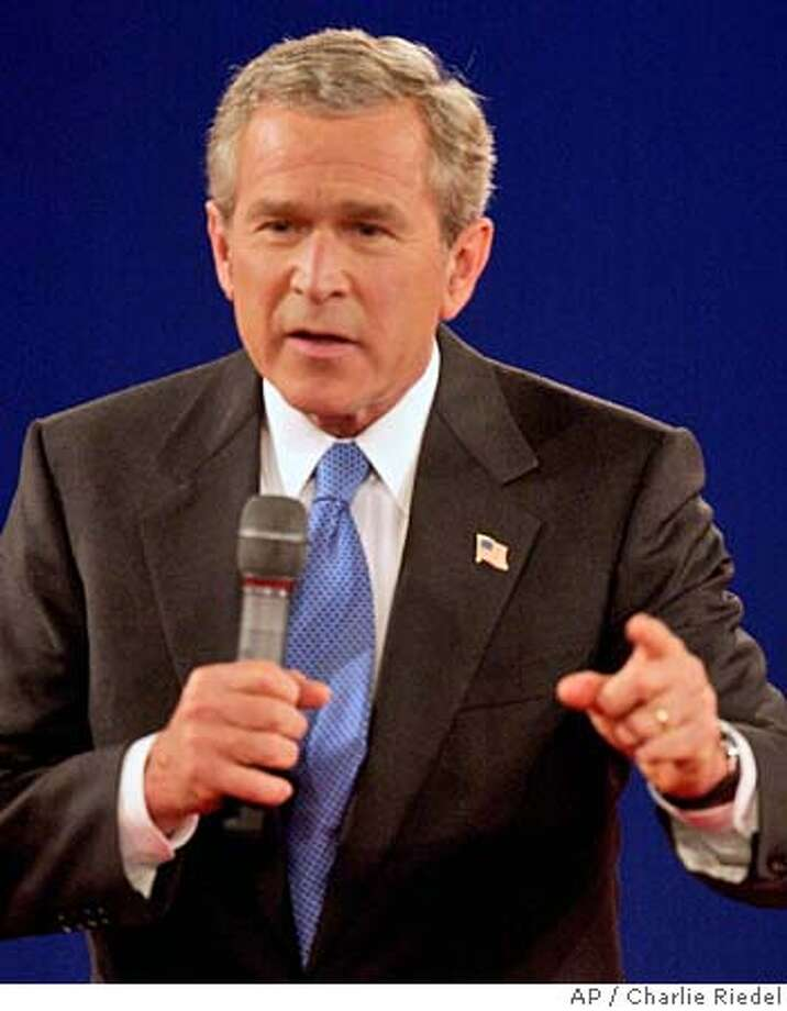 President Bush answers a question during the presidential debate Friday, Oct. 8, 2004, at Washington University in St. Louis. (AP Photo/Charlie Riedel) Photo: CHARLIE RIEDEL