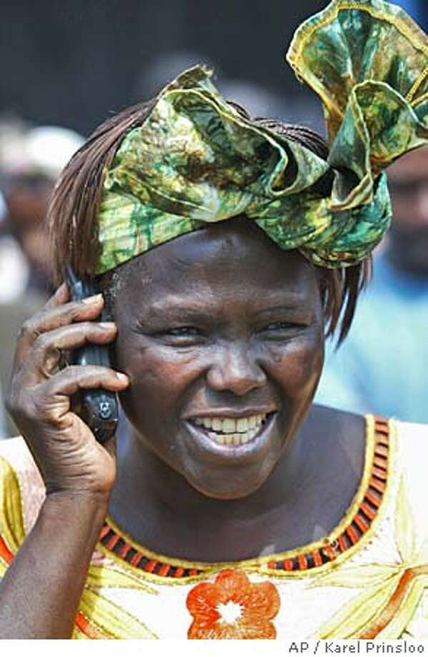 Kenyan environmental activist Wangari Maathai speaks on the phone as she is congratulated, Friday, Oct 8, 2004 in Ihururu near Nyeri after she won the Nobel Peace Prize on Friday for her work as leader of the Green Belt Movement, which has sought to empower women, better the environment and fight corruption in Africa for almost 30 years.(AP Photo/Karel Prinsloo) Photo: KAREL PRINSLOO