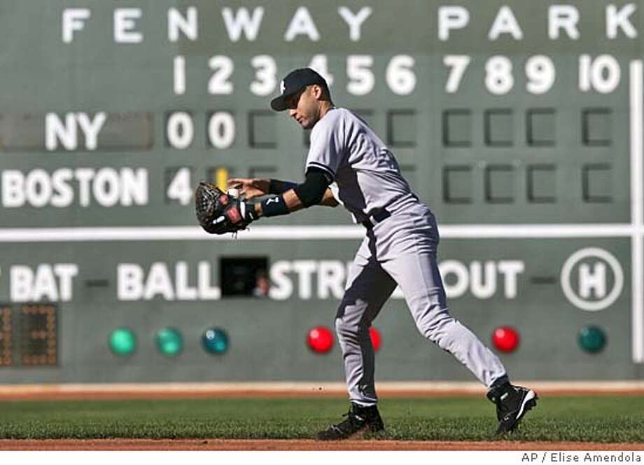 New York Yankees shortstop Derek Jeter has trouble getting the ball out of his glove on a grounder by Boston Red Sox Jason Varitek during the second inning at Fenway Park in Boston Sunday, Sept. 26, 2004. Jeter then made a throwing error to home allowing David Ortiz to score. (AP Photo/Elise Amendola) Datebook#Datebook#Chronicle#10/9/2004#ALL#5star##0422375057 Photo: ELISE AMENDOLA