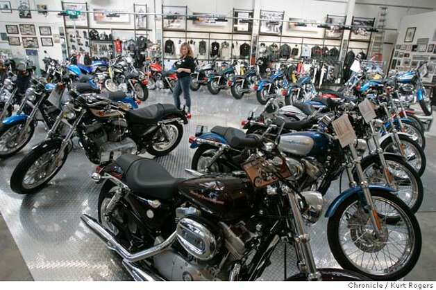 The New show room at Dudley Perkins Motorcycle shop on South Vanness.  Dudley Perkins Motorcycle Shop. The shop is one of the nation's oldest dealers of Harley Davidsons. It was founded in 1914 by legendary motorcycle racer Dudley Perkins. It has survived four generations, the Depression, a world war, down times and boom times. The weekend ahead is full of festivities, including an antique bike show and a gutteral ride from sf over to treasure island.  MOTORCYCLES_0091_kr.JPG 10/7/04 in San Francisco,CA.  KURT ROGERS/THE CHRONICLE MANDATORY CREDIT FOR PHOTOG AND SF CHRONICLE/ -MAGS OUT Metro#Metro#Chronicle#10/9/2004#ALL#5star#b6#0422400153 Photo: KURT ROGERS