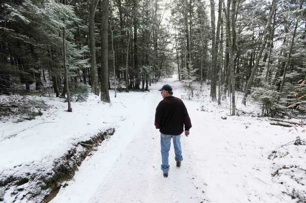 Paul Kondrat of Hinsdale, N.H., walks Thursday, Jan. 26, 2012, near the place where his late father, Edward Kondrat, discovered the body of murder victim Mary Harrison, a Greenwich native, in the woods on Oct. 30, 1981. Photo: Bob Luckey / Greenwich Time