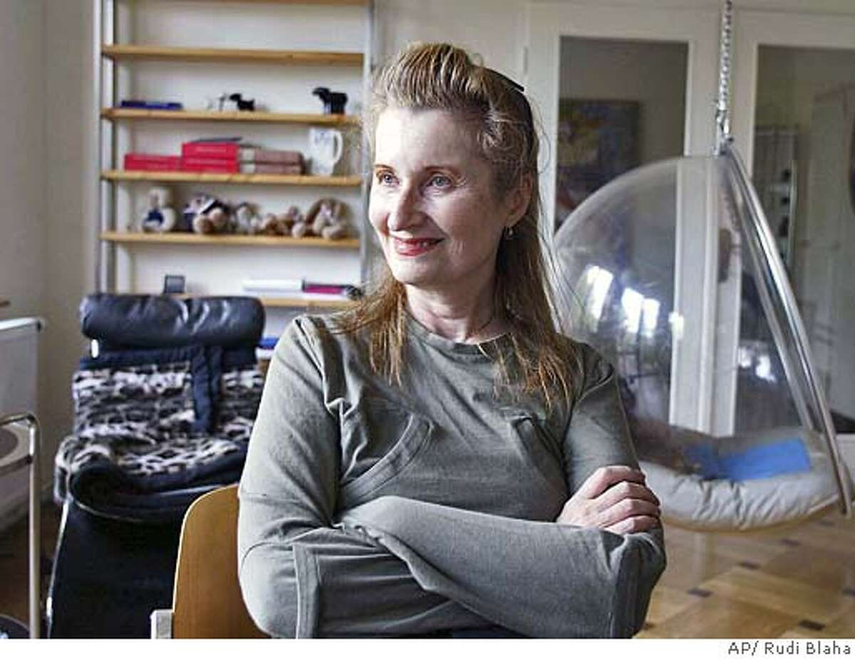 ** RERUN TO CORRECT SPELLING OF FIRST NAME ** Austrian Nobel Prize Winner in literature, novelist and playwriter Elfriede Jelinek is seen in her home in Vienna during an interview with the AP on Thursday Oct. 7, 2004, after the award was announced . (AP Photo/Rudi Blaha) RERUN TO CORRECT SPELLING OF FIRST NAME Datebook#Datebook#Chronicle#10/9/2004#ALL#Advance##0422399432