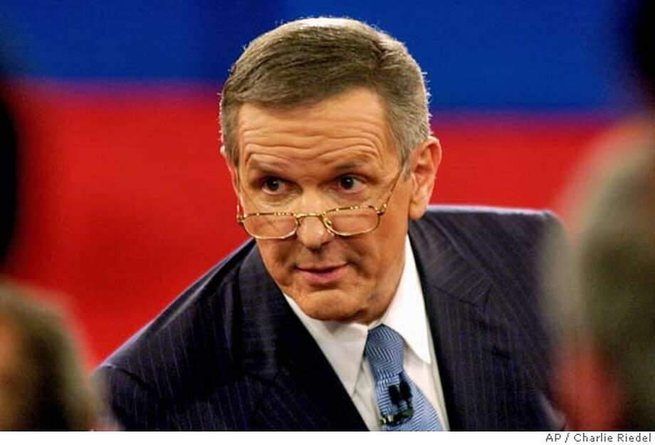 Moderator Charlie Gibson addresses the audience prior to the presidential debate Friday, Oct. 8, 2004, at Washington University in St. Louis. (AP Photo/Charlie Riedel) Photo: CHARLIE RIEDEL