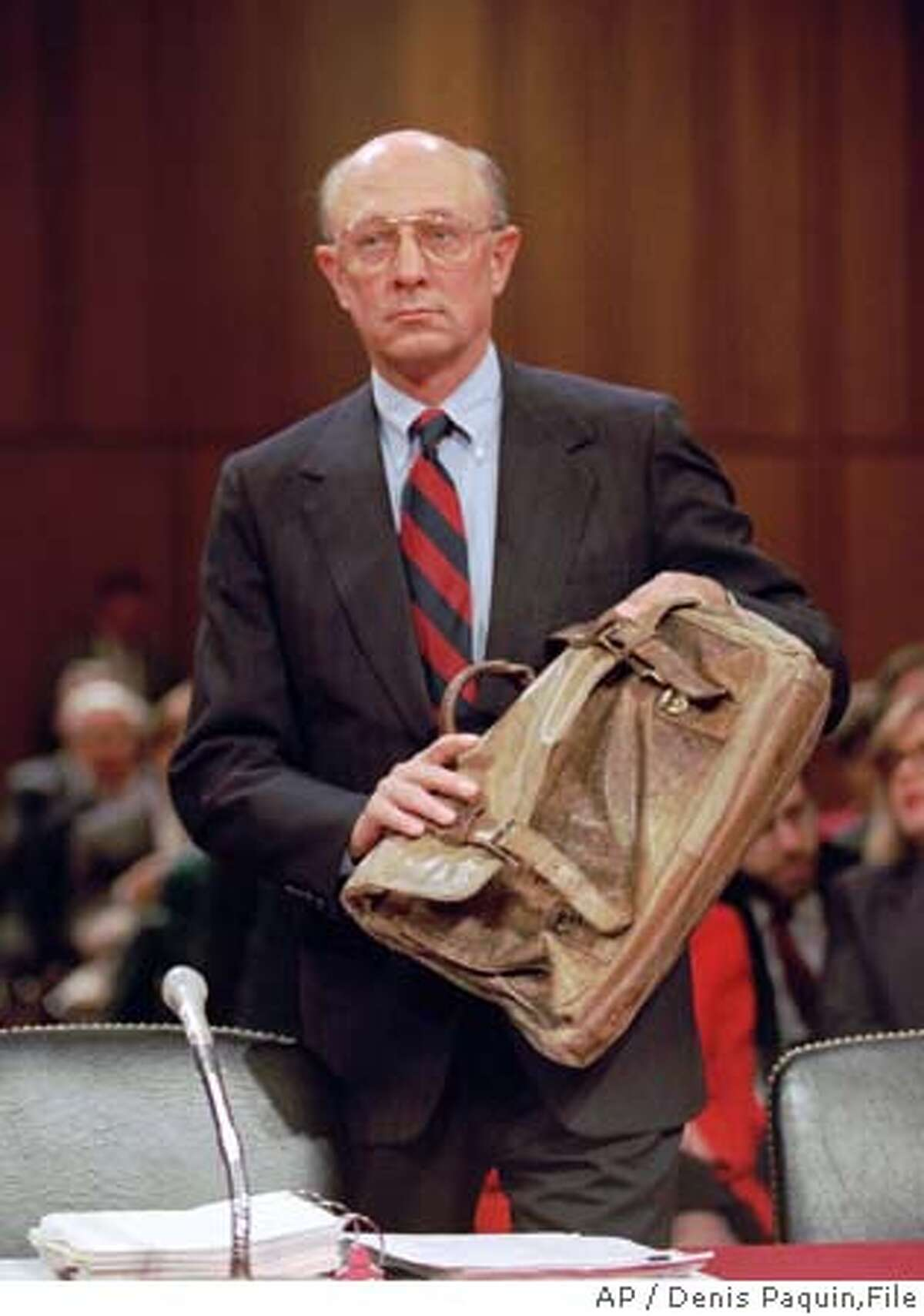 Outgoing CIA Director R. James Woolsey arrives on Capitol Hill Tuesday, Jan. 10, 1995, to testify before the Senate Intelligence Committee. Woolsey, on his final day as CIA director, told the committee Tuesday he could not assure the American people that the agency could avoid another spy scandal like the Aldrich Ames case. (AP Photo/Denis Paquin) ALSO RAN: 5/29/97 CAT