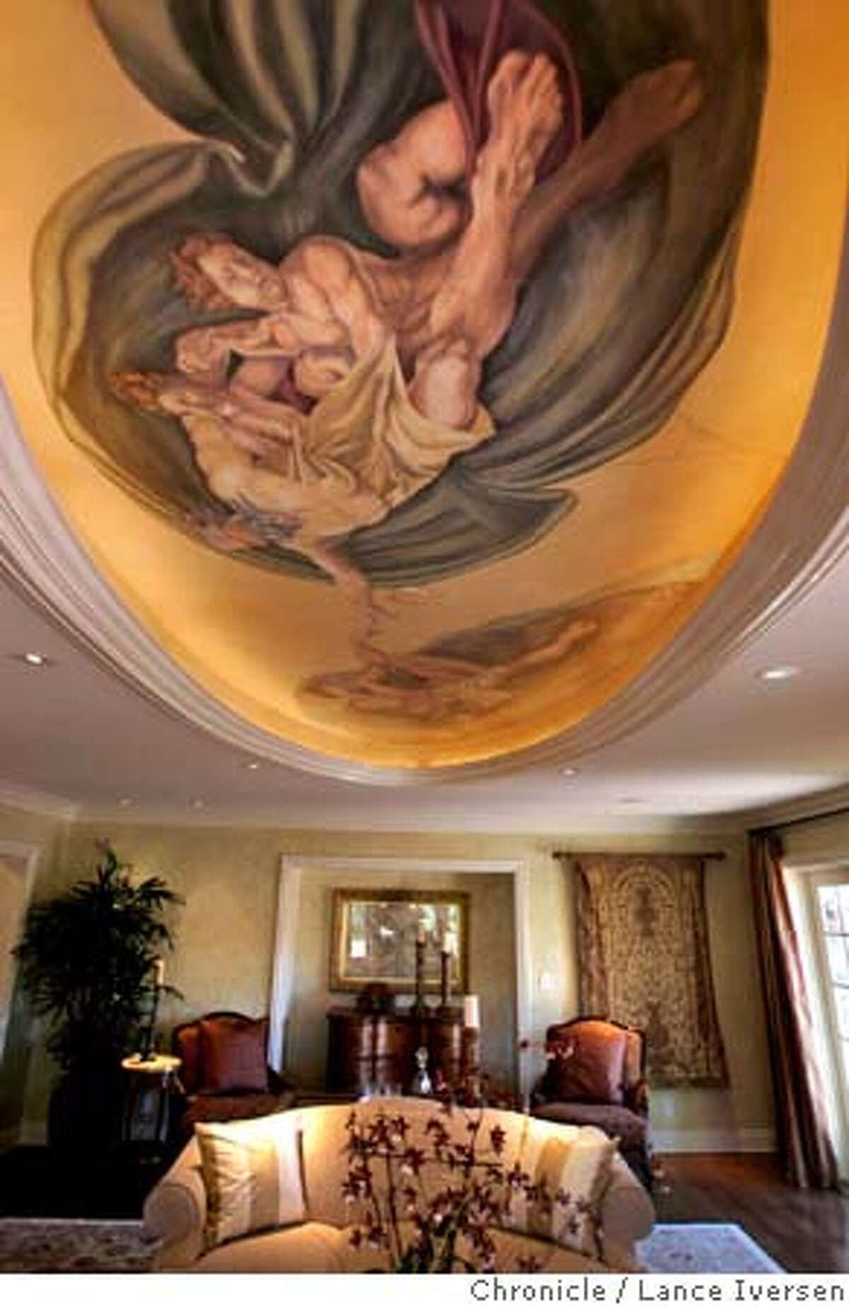 LESHER01_231.jpg_ A large fresco style painting adorns the ceiling of the formal living room at the Seven Oaks estate; Seven Oaks is the former estate of the late Dean Lesher, founder of the Contra Costa Times newspaper, is on the market at an asking price of almost eight million dollars. Or so. The media toured of the property Thursday morning. Pacific Union Salesman Steve Mavromihalis and Gil Fleitas pointed out the lavish appointments that included a home theater, ballroom and indoor and outdoor pools, plus a waterfall on the 4.3 Orinda estates. By Lance Iversen/San Francisco Chronicle MANDATORY CREDIT PHOTOG AND SAN FRANCISCO CHRONICLE.