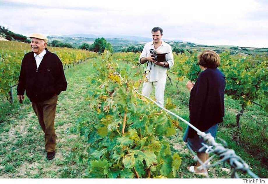 "(NYT17) SARDINIA, Italy -- March 15, 2005 -- WINE-FILM -- Jonathan Nossiter with camera and Battista and Lina Colombu in Sardinia, Italy, from the 2004 documentary film ""Mondovino."" (ThinkFilm/The New York Times) *ONLY FOR USE WITH STORY ENTITLED WINE-FILM by Eric Asimov. All other use prohibited* Photo: ....."