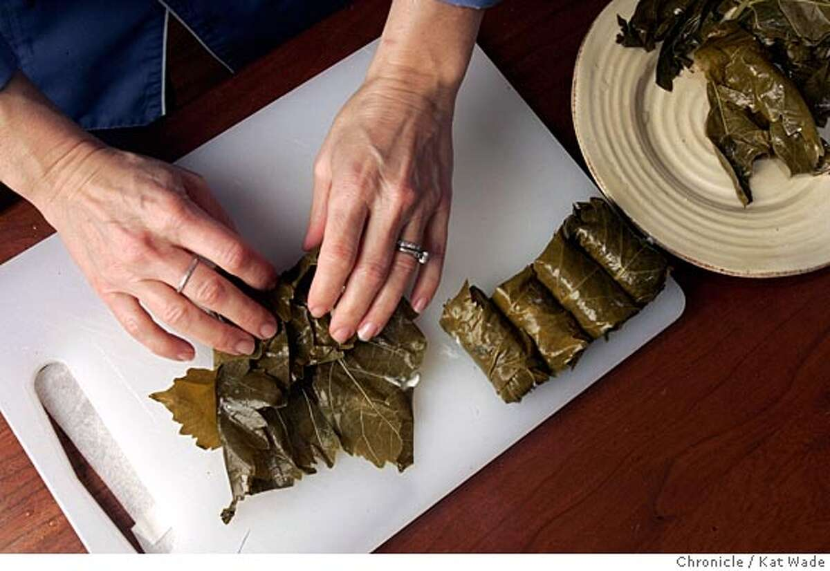 """On 2/8/05 Cat Cora, who is the first female chef on the new """"Iron Chef America"""" which debuted this month on the Food Network, prepares Grape Leaves stuffed with smoked salmon rillettes for a Mediterranean meal for an upcoming dinner party in Napa in her Fairfield home. Kat Wade/ The Chronicle"""
