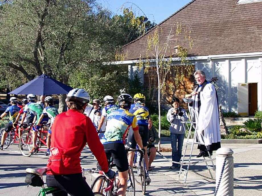 Saint Bede's Episcopal Associate Rector Dennis Tierney celebrates the first . The Menlo Park, California church is located on Sand Hill Road, a popular cyclist corridor. Photo: Brian Douglas