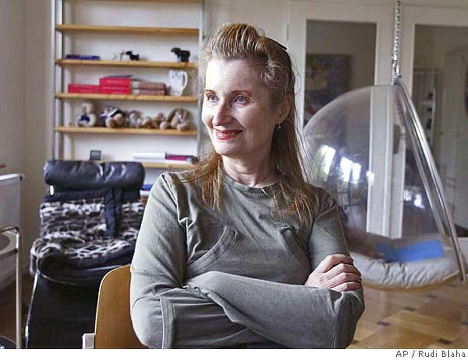 ** RERUN TO CORRECT SPELLING OF FIRST NAME ** Austrian Nobel Prize Winner in literature, novelist and playwriter Elfriede Jelinek is seen in her home in Vienna during an interview with the AP on Thursday Oct. 7, 2004, after the award was announced . (AP Photo/Rudi Blaha) Photo: RUDI BLAHA