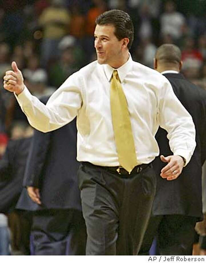 Iowa head coach Steve Alford reacts at the end of his team's 71-69 upset win over Michigan State in the quarterfinals of the Big Ten tournament Friday, March 11, 2005, at the United Center in Chicago. (AP Photo/Jeff Roberson) Photo: JEFF ROBERSON