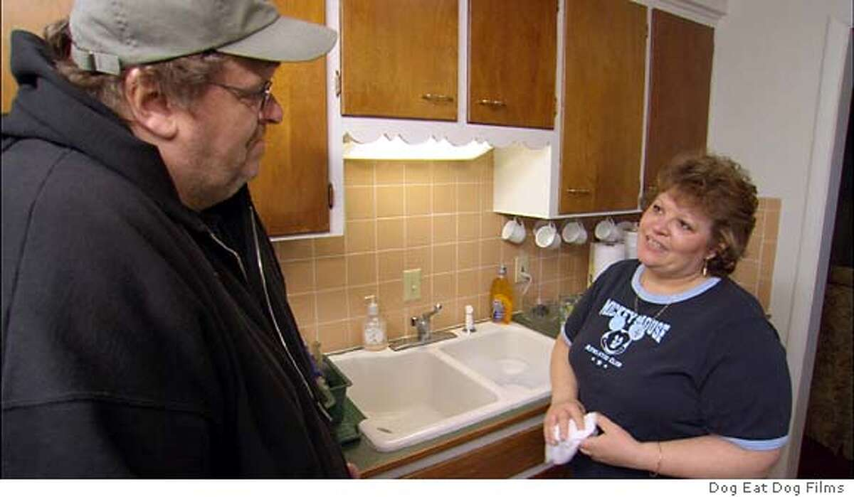 Lila Lipscomb, a mother of two veterans, in Flint, Michigan talks with filmmaker Michael Moore in a scene from Moore's new documentary film