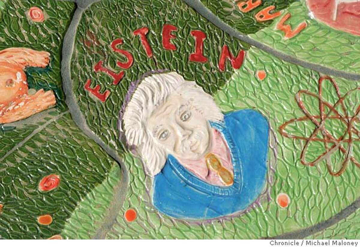 """MURAL005_MJM.jpg Einstein is missing the """"n"""". A $40,000 ceramic mural unveiled outside Livermore's new library when it opened earlier this year will cost the city $6,000. because of the artist's misspelled names. Einstein, Shakespeare, Vincent Van Gogh, Michelangelo and seven other historical figures were misspelled. """"Our library director is very frustrated that she has this lovely new library and it has all these misspellings in front,"""" said city councilwoman Lorraine Dietrich, one of three council members who voted Monday to authorize paying another $6,000, plus expenses, to fly the artist up from Miami to fix the errors. Artist Maria Alquilar said she was willing to fix the brightly colored 16-foot-wide circular work, but offered no apologizes for the 11 misspellings among the 175 names. """"The importance of this work is that it is supposed to unite people,"""" Alquilar said. """"They are denigrating my work and the purpose of this work."""" Photo by Michael Maloney / San Francisco Chronicle MANDATORY CREDIT FOR PHOTOG AND SF CHRONICLE/ -MAGS OUT Nation#MainNews#Chronicle#10/8/2004#ALL#5star##0422400032"""