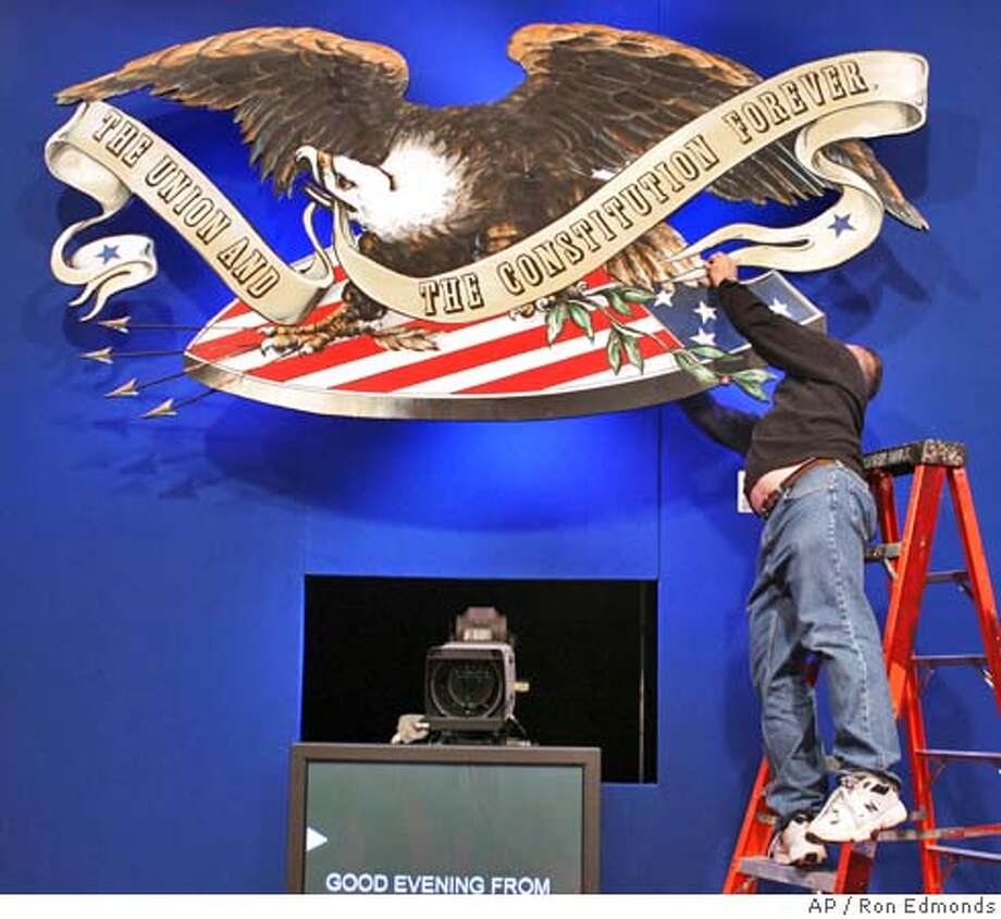 A worker puts the finishing touches on the backdrop at Washington University in St. Louis Thursday, Oct. 7, 2004, in preparation for Friday's presidential debate. (AP Photo/Ron Edmonds) Nation#MainNews#Chronicle#10/8/2004#ALL#5star##0422399905 Photo: RON EDMONDS