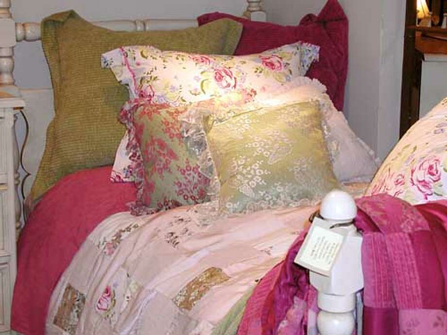 """Bella Notte bedding items on sale: From top left to bottom right, Cloud Cord Euro Shams, Lulu Raspberry Standard Sham, Lily Lace 16"""" throw pillows over 16"""" Satin pillow slip, Cloud Cord 18"""" throw pillow, Rebecca Twin Flat Sheet, Gwen Twin Duvet Cover and Gwen Throw Blanket."""