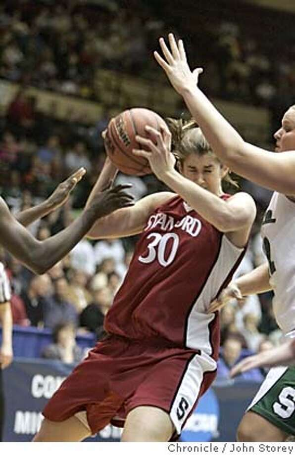 Stanford_jrs_0359_jpg  Azella Perryman of Stanford drives against Kelli Roehrig of Michigan State. Stanford Cardinal vs. the Michigan State Spartans in the NCAA Regional Women's Basketball Championship in Kansas City. John Storey Kansas City Event on 3/29/05 MANDATORY CREDIT FOR PHOTOG AND SF CHRONICLE/ -MAGS OUT Photo: John Storey