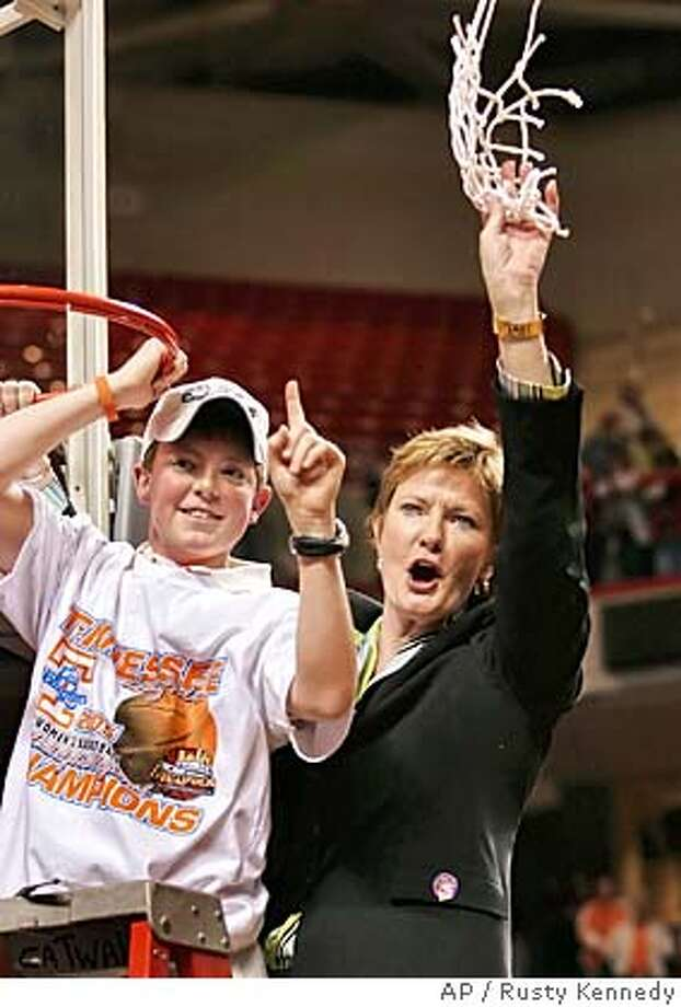 Waving a piece of the net, Tennessee coach Pat Summit and her son, Tyler, celebrate a win over Rutgers in their NCAA regional final game in Philadelphia Tuesday, March 29, 2005. Tennessee won, 59-49 to advance to the Final Four. (AP Photo/Rusty Kennedy) Photo: RUSTY KENNEDY